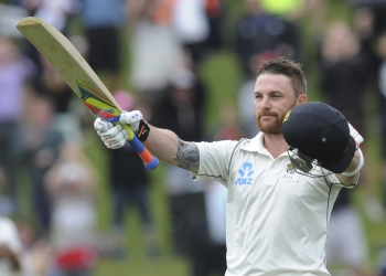 New Zealand's Brendon McCullum celebrates his triple century against India on the final day of the second test  at the Basin Reserve in Wellington, New Zealand, Tuesday, Feb. 18, 2014. (AP Photo/SNPA, Ross Setford) NEW ZEALAND OUT