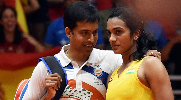 Rio de Janeiro: India's Pusarla V Sindhu with coach Pullela Gopichand after she lost against Spain's Carolina Marin in women's Singles final at the 2016 Summer Olympics at Rio de Janeiro in Brazil on Friday. PTI Photo by Atul Yadav (PTI8_19_2016_000310b)