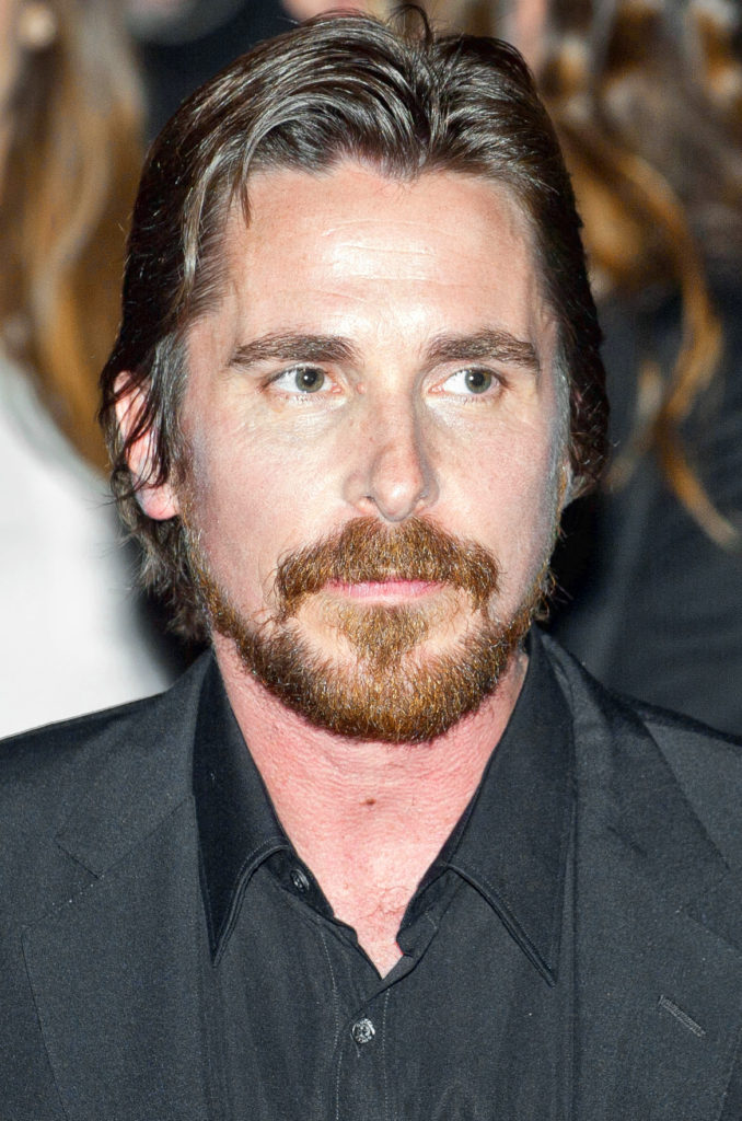 """Actor Christian Bale leaving the press conference for the movie """"American Hustle"""""""