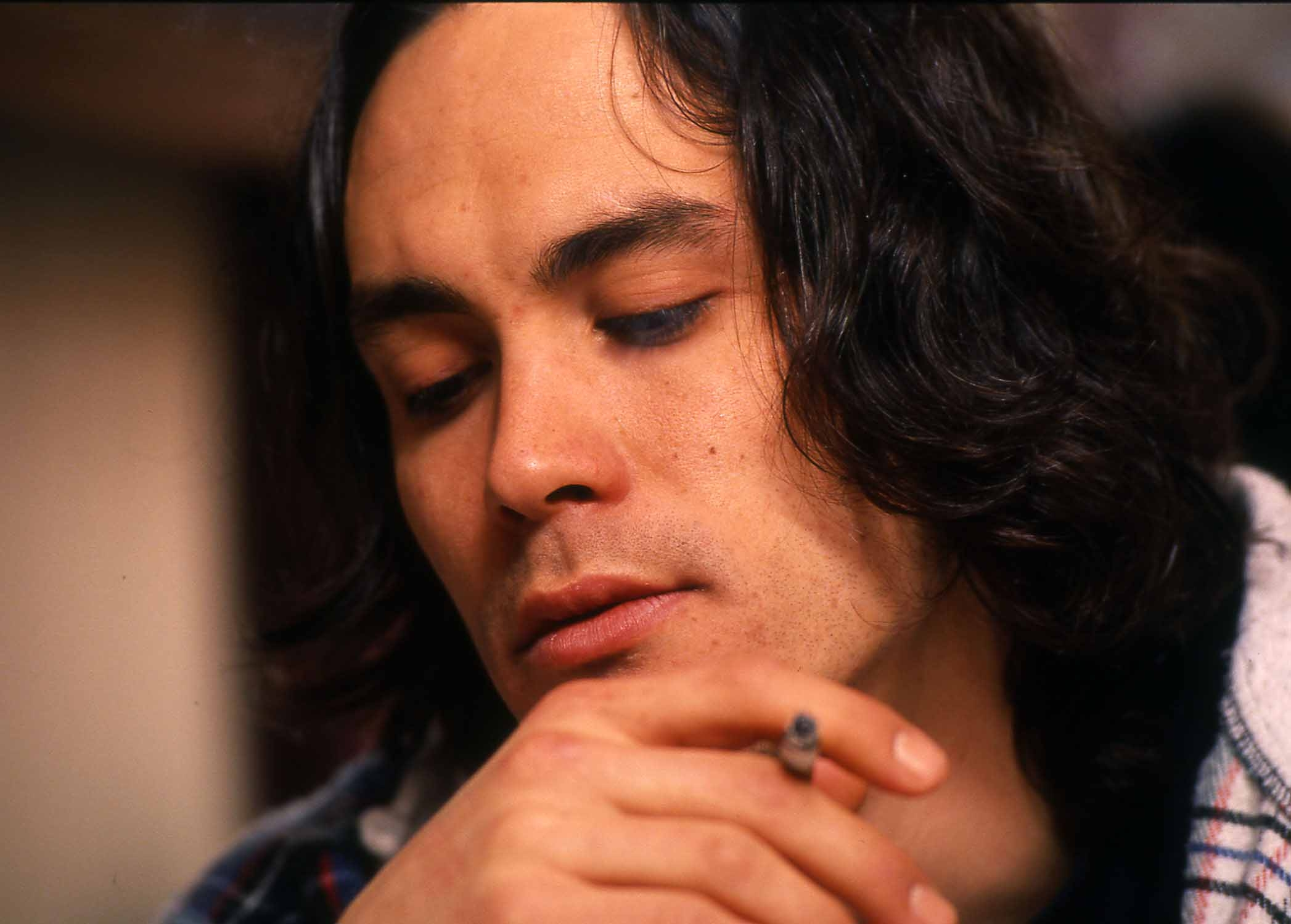 Actor Brandon Lee chain smokes cigarettes in his trailer during a late-night interview on March 23, 1993, the week before he died on the set of The Crow in Wilmington, N.C. - Photo by Jamie Moncrief / Wilmington Star-News