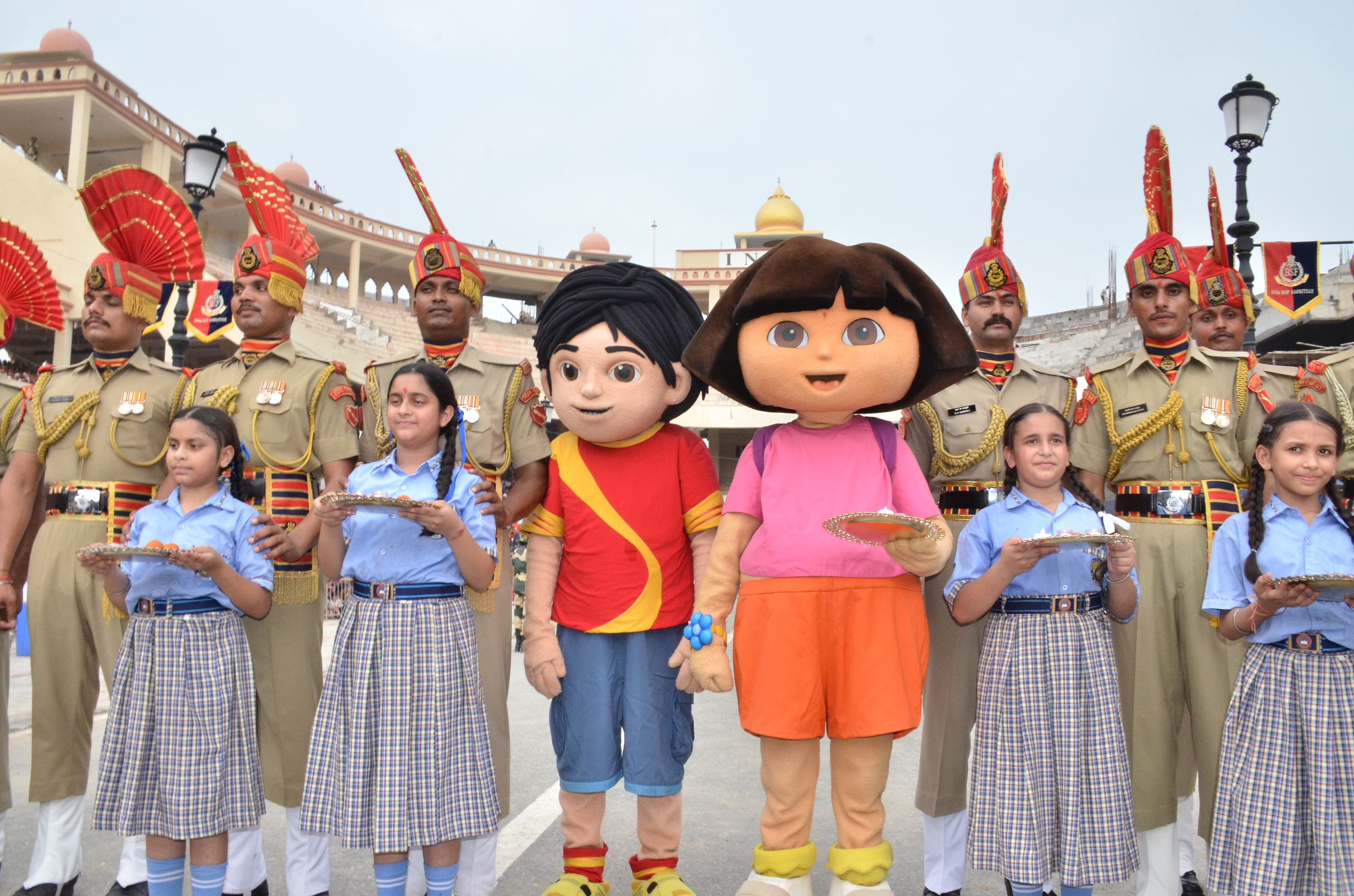 "Photo of Children celebrate Surakshabandhan with the nation's first line of defense ""The Border Security Forces"""
